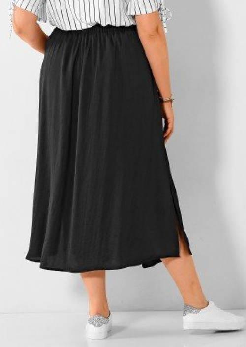 Jednobarevná černá sukně pro baculky